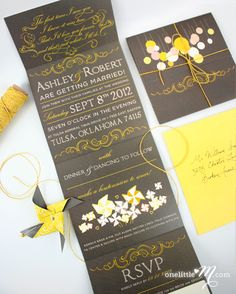 Beaumont, by onelittlem. Look at the fantastic little windmills included in these wedding invitations. Very elegant in grey and yellow, but with that touch of whimsy.