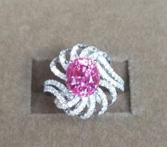 4 ct Hot pink natural spinel with diamond ring. Custom designed.