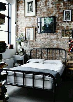 Bedroom styling .love that brick wall