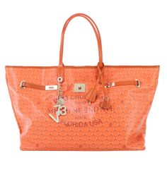 #V73 Miami Bag Big Size Orange Shop now on https://www.v73.us/borse-shopping/miami #Miami #Bag Concealed magnetic snap closure, Printed canvas, Charms shown in photo included, Metal feet at the base, Pochette inside.H: 30 CM W: 55 CM D: 16 CM