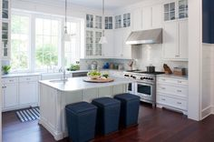 Traditional Kitchen with Farmhouse Sink, Kitchen island, Flat panel cabinets, L-shaped, Glass panel, High ceiling, Flush