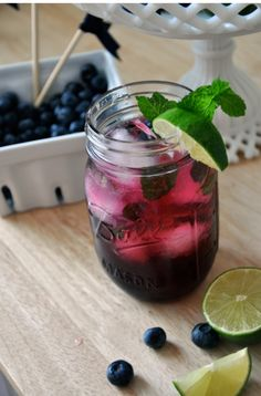 Blueberry Mojito   1 cup sugar, 1 cup water, 1 cup fresh blueberries, clear rum (optional),  fresh mint, 1 lime, soda water
