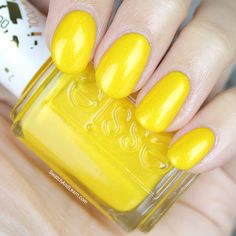 Eat your heart out, canaries! This shimmering citron is Essie's 1000th shade called Aim to Misbehave! (See a detailed review on SwatchAndLearn.com. Also includes swatches in natural light.)