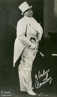 "As the popularity of vaudeville declined following World War I, cross-dressing performances transitioned to nightclubs and burlesque revues.  Accordingly, the next woman to achieve celebrity status in men's formal wear was Gladys Bentley, an African-American blues singer popular during the Harlem Renaissance. She appeared in the 1920s at Harry Hansberry's ""Clam House"", one of New York City's most notorious gay speakeasies, and headlined in the early thirties."