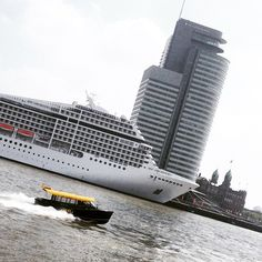 Cruiseship, watertaxi on the Maas and Hotel New York in Rotterdam. Photo: @wilma1974
