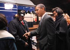 Michelle Obama and Malia Obama Photos Photos - President-Elect Barack Obama (3rd-L) speaks with train conductor Noel Powell (2nd-L) as his wife Michelle Obama (R) and Malia, 10, (L) wait to board during his whistle-stop train trip to Washington beginning here at the 30th Street Station on January 17, 2009 in Philadelphia, Pennsylvania. The Obamas will travel by train from Philadelphia to Washington with a stop in Wilmington, Delaware, to pick up Vice President-elect Joe Biden, going forward…