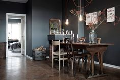 I love this table and the hung wire with clips. my scandinavian home: One Swedish apartment, two different ways of doing grey Sweet Home, Interior Walls, Interior Design, Wooden Table And Chairs, Dark Grey Walls, White Walls, Mad About The House, Dark Interiors, Rustic Interiors