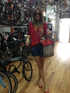 Olivia Palermo in shorts by Ann Taylor, top by Reiss, beaded necklaces by Charming Charlie, bag by Furla, and ballet flats by French Sole.