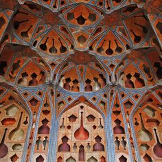 acoustical wall and ceiling treatment in the music room of the 300-year old ali qapu palace on naqsh-e jahan square in esfahan, iran. the cutouts are shapes of instruments and vessels.