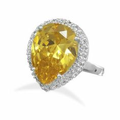 Silver Plated Pear Shape Yellow Clear CZ Ring 925 Sterling Silver Plated Brass Pear Shape Yellow and Clear CZ Fashion Ring W8022  Silver plated brass ring with pear shape yellow CZ. The pear shape stone measures 11mm x 16mm and is surrounded with clear CZs. This ring is available in whole sizes 5-9. This ring is nickel free and lead free. High Quality Fashion Jewelry. Looks like the real thing! Gorgeous! Jewelry Rings