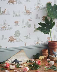Overview Capture the imagination of nature-loving children and adults alike with a whimsical landscape of desert cactus and roaming dinosaurs for your home. Designed in a pink and green hue for a soph
