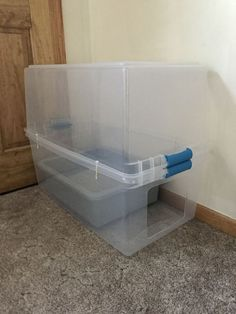DIY cat liter box. Helps prevent the dust and smell from consuming the room.