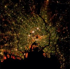 """10/1/2014 Tokyo Tokyo, Japan 35°41′22.22″N139°41′30.12″E  Tokyo, seen here at night from the International Space Station, is the most populous metropolitan area in the world with upwards of 37.8 million people.  This photograph is courtesy of NASA's""""Cities at Night""""project.Through this effort, NASA has invited the public to sift through its collection of more than 1.8 million photographs captured from the ISS since 2003. With crowdsourcing, we will be able to identify and catalogue ..."""