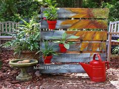 painted sunflowers and potted plants. Love this look and want to do something like this on my old garden gate.