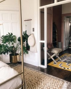Start your summer day with an easy strawberry recipe and end it unwinding in this serene but trendy living space - with a pop of leopard print, of course. 📷 @dakota_ness expertly mixes a big potted plant (hello monstera plant!) with chill white walls, layered rugs, a four post bed, and a leopard print ottoman that can be moved around to meet whatever need you may have. This mood feels both trendy and timeless, there are a lot of ideas for your bedroom refresh in this little space. Modern Bohemian Decor, Modern Decor, Big Potted Plants, Farmhouse Interior, Neutral Colour Palette, Modern Fabric, Upholstered Furniture, Eclectic Style, Bedroom Inspiration