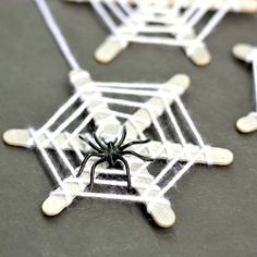 These craft stick spiderwebs are easy for kids to make and really inexpensive!