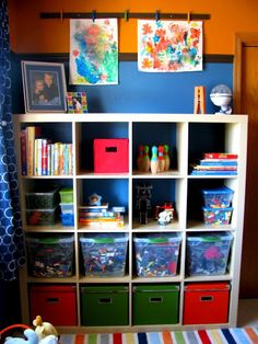 Love the idea of a magnetic strip w/ metal clothes pins to display/dry artwork in the playroom.