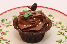 With a rich chocolate sponge, a light and creamy chocolate buttercream topping and creamy filling, these yule log cupcakes are the perfect naughty Christmas cupcake recipe. Taking a traditional yule log and turning it into a cupcake is a great way to transform this traditional Christmas recipe. You can top your cupcakes with a variety of edible decorations. Our cupcake queen, Victoria Threader, made these cakes with chocolate flakes on top and a cute robin.