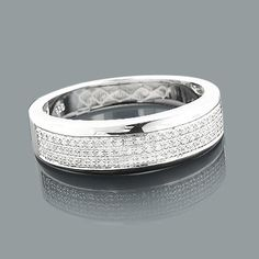 Affordable Sterling Silver Wedding Bands: This Mens Diamond Ring weighs approximately 4 grams and showcases carats of genuine diamonds. Featuring a classic design and a luxurious rhodium plating for extra shine, this men's diamond ring is a great alt Unusual Wedding Rings, Wedding Rings For Women, Sterling Silver Diamond Rings, Silver Diamonds, Diamond Jewelry, Silver Jewelry, Silver Earrings, Silver Wedding Bands, Diamond Wedding Rings