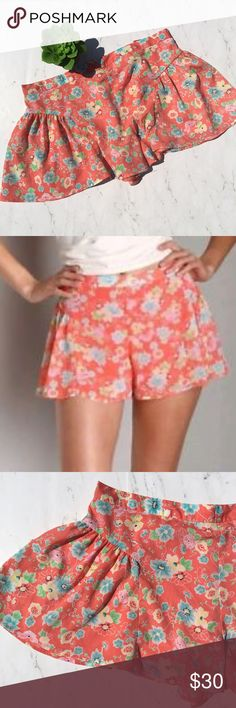 """Free People Size 6 Chiffon Floral Coral Shorts This is a pair of Free People Chiffon Shorts • Size: 6 • Color: Coral / Peach / Pink • Excellent used condition • Floral print • Pleated on sides • Flowy • Lined • Zipper + hook & eye back closure • Made of 100% Polyester (Shell and Lining) • Machine wash • Madejin China • RN# 66170 • Approx measurements: Waist: 32"""". Inseam: 2"""". Length: 12"""" • Free People Shorts"""