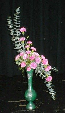 Garden Club Journal a traditional design - hogarth curve flower arrangement Rosen Arrangements, Tropical Floral Arrangements, Church Flower Arrangements, Beautiful Flower Arrangements, Beautiful Flowers, Contemporary Flower Arrangements, Altar Flowers, Church Flowers, Funeral Flowers