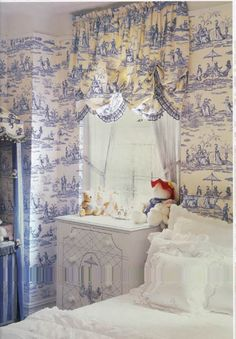 Toile works well in an overall look like this. The window treatment is especially pretty. Very refreshing room.