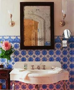 blue tile and old mirror - #bathroom Handmade tiles can be colour coordinated and customized re. shape, texture, pattern, etc. by ceramic design studios