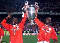 Dwight Yorke and Andy Cole Lifting the The Champions League Trophy in 1999