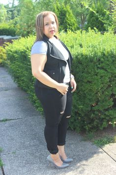 I'm not a player I just blog a lot t shirt. Black distressed jeans. Black Stylzoo moto vest. Black and white stripe pumps. Plus size fashion blogger. Curvy fashion. Outfit inspiration