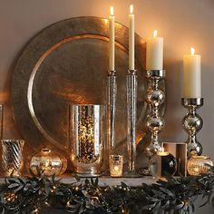 Silver platters w/silver candlesticks...add some garland and holly for Christmas.