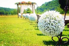 Babies Breath pomanders on Iron Shepherd hooks that stand on their own..for inside and outside decor.. For Rent @ Flowers by Tammy