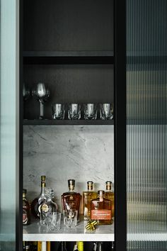 Black on black: A sleek and dramatic home tour. Hidden bar in kitchen, stylish home bar Chiaroscuro, Reeded Glass, Interior Design Awards, Interior Ideas, Interior Styling, Masculine Interior, Timber Staircase, Home Bar Designs, Drinks Cabinet