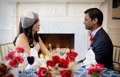 Valentine's Day inspiration shoot from Dogwood Events. Photography by Kristen Gardner Photography. Flowers by Holly Chapple Flowers. Dress from Fabulous Frocks of Alexandria. Suit from Christopher Schafer Clothiers. Beauty by Amie Decker Beauty. #Valentine #wedding #bride #groom #sweetheart #table #centerpiece #fireplace #red #blue #Virginia