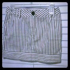 Striped short skirt Striped skirt, with to pockets in the front, and it zips up in the front, right under the black button Forever 21 Skirts Mini