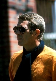 Steve McQueen in scarf and bright yellow knitwear