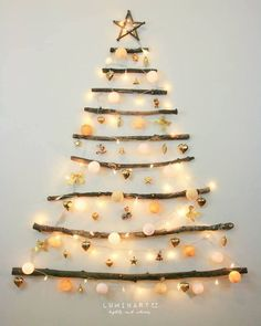 Christmas Decor DIY Ideas To Get Crafting for the Holidays Right Now! - Hello Lovely : Driftwood Christmas tree - CLICK OVER to find Christmas Decor DIY Ideas to Get Crafting for the Holidays Right Now as well as Decorating ideas! Driftwood Christmas Tree, Creative Christmas Trees, Hanging Christmas Tree, Indoor Christmas Decorations, Decorating With Christmas Lights, Simple Christmas, Handmade Christmas, Christmas Holidays, Christmas Crafts