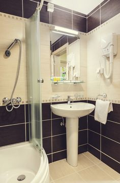 White Pedestal Sink With Mounted Mirror And Shelf Above