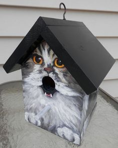 This bird house is a hand painted EXAMPLE of a long haired cat with orange eyes. Each birdhouse is one of a kind. Custom orders of various cat breeds are welcome. Makes a great gift for the cat lover! Hand painted wood with acrylics and sealed with several layers of varnish. Hook is
