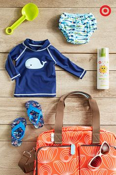 """""""A day at the beach"""" takes on a new meaning when you have a baby. Get ready for fun in the sun with all the essentials packed in the colorful Orla Kiely for Target diaper bag—hat, swim diapers, sandals, sunscreen, toys and, of course, fashionable sunglasses! Now you're good to go."""