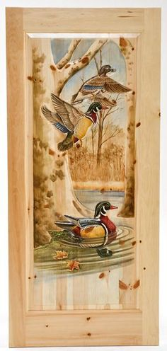 Hand carved rustic door featuring wood ducks by Woodland Creek Furniture