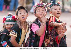 chiang rai coffee   CHIANG RAI, THAILAND - JANUARY 5, 2012: Hmong ethnic minority kids are ...