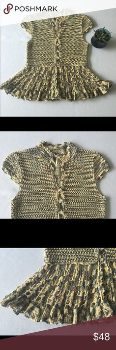 """Free People Cotton Cap Sleeve Sweater Pearl Button Free People Cotton Cap Sleeve Sweater Pearl Buttons.  Adorable sweater top. 100% cotton.   Crochet Peplum bottom.  Faux pearl buttons.    Excellent used condition!    NO FLAWS!!!!!   Armpit to armpit 15"""".      Length 22"""" from shoulder.   Cute with jeans or dress pants! Free People Sweaters V-Necks"""