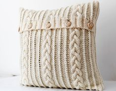 Cable knit pillow wool cover - milk white decorative pillows case - handmade home decor 26x26 Specifications: Fiber content: 50% wool/ 50% acrylic (pleasant for touch) Technology: closure - 5 wooden buttons, no lining inside. Size: 26x26.inch Color: ivory Status: Handmade to order, takes about 2-3 weeks Pillow cover knitted by hand at home. Milk white color -makes it very cozy detail Story about it: My best friends mother asked once if there would be a way to sell something on Etsy, but…