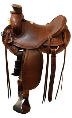 "16"" Showman™ Saddle. This saddle features square basket weave tooling on pommel, cantle, skirts, fenders and jockies This saddle is equipped with aluminum stirrups with leather tread and a buckle strap attached to the pommel."