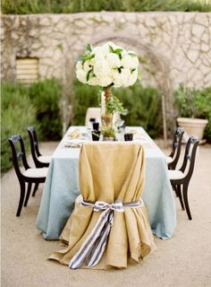 Love that the chair cover looks like a table cloth or a big piece of fabric. I can so do this!