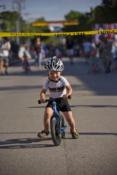 One shining moment of toddler riding bicycle by Jeffrey Phelps