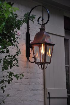Lovely copper exterior light for a Mediterranean style home with lots of wrought iron details. Would look gorgeous next to a stained wood door.