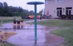 My Splash Pad Poland, OH freeform installation with 12 nozzles, an Umbrella water play feature and a stamped finish concrete that was dyed a chocolate brown. This was a beautiful setting!!! #splashpad #splashpadfun #waterplayfeature #waterplay