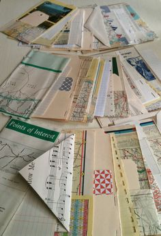 A travel smash book or road trip junk journal with recycled vintage maps and ephemera paper. This 5x7 inch journal is bound with two inch binder rings