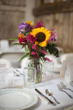 Loving the sunflower amongst the colourful flowers, would make a gorgeous centrepiece at a wedding or at home.